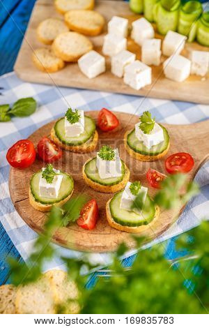 Bread Rusks Topped With A Cube Of Feta