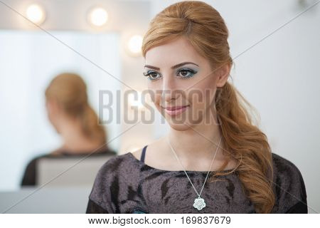 Portrait of beautiful girl in make up studio