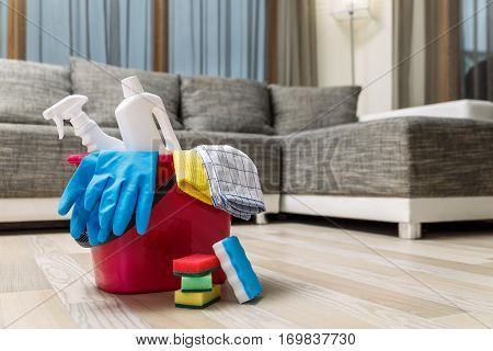Cleaning service. Bucket with sponges, chemicals bottles. Rubber gloves and towel. Household equipment.