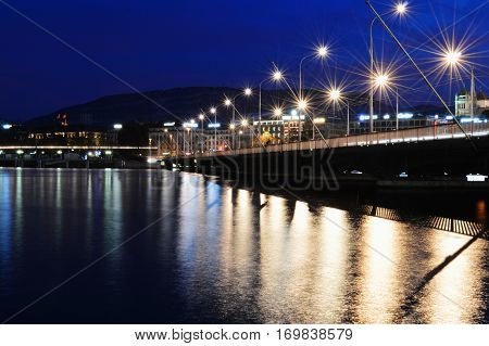 Bridge in the autumn night on lake Geneva lake Geneva Switzerland