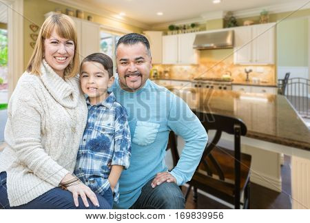 Happy Mixed Race Young Family Inside Beautiful Kitchen of Their House.