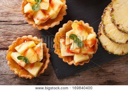 Mini Tart With Fresh Pineapple And Jam Closeup. Horizontal Top View