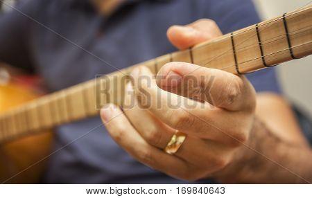 Closeup Shot Of A Man Playing Baglama (Turkish traditional stringed instrument) - Saz