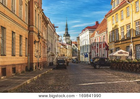 TALLINN ESTONIA - JULE 29 2013: Medieval street of old town Tallinn with St. Nicholas church in summer morning