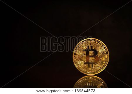 Golden Bitcoins On Black Background. Trading Concept Of Crypto Currency