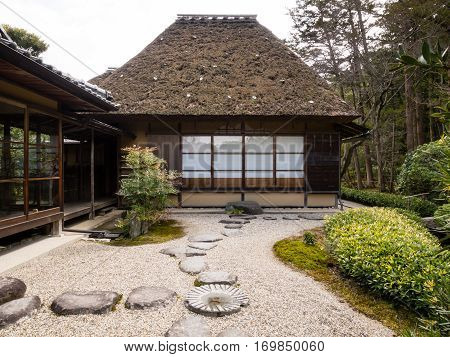 Nara, Japan - March 13, 2013: Traditional Japanese rock garden with tea house - in Isuien Garden