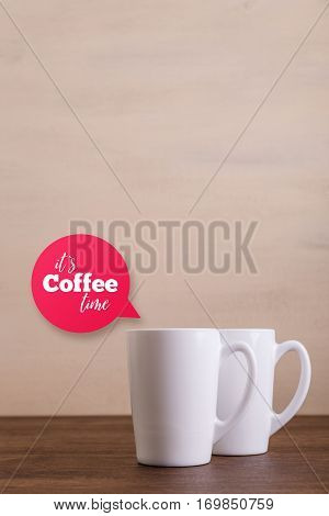 Mock-up mugs. Mockup coffee or tea cups. Its coffee time speech bubble. Design concept for branding. Front view. Wooden rustic board.