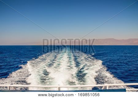 Yacht trail foaming behind a ferry boat inRed sea, Egypt, Africa