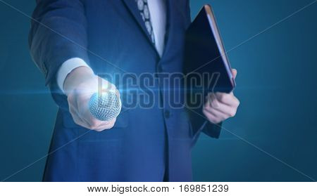 Businessman Holds Out The Microphone To Speak.