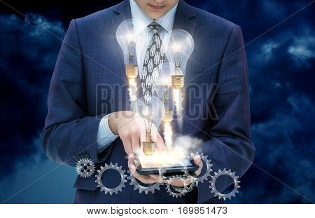 Businessman on a mobile device developing a strategy for the market.