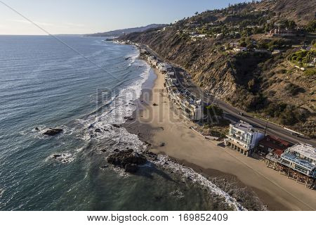 Aerial of beachfront homes Pacific Coast Highway in Malibu California.