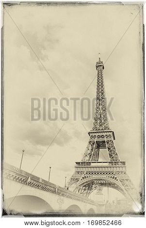 vintage View of the Eiffel Tower at sunset with ferry sailing on the River Seine