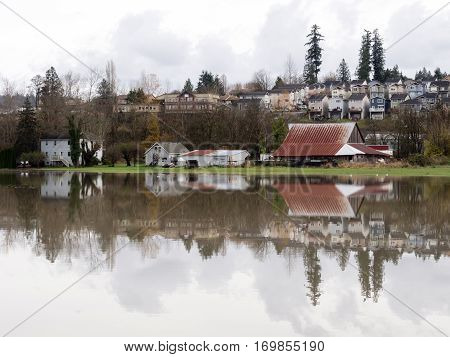Duvall, WA, USA - November 19, 2015: Snoqualmie river floods farmlands and roads under water