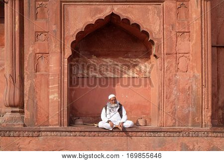 DELHI, INDIA - FEBRUARY 13: Old man relaxing at Jama Masjid Mosque on February 13, 2016, Delhi, India.