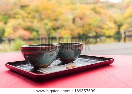 Japanese green tea with autumn background