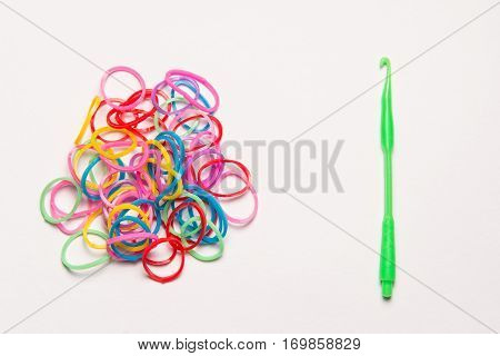 Rubber bands and hook on white background. Office supplies. Assortment of stationery.