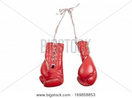old battered red leather boxing gloves with laces, isolated on white background
