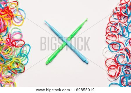 Rubber bands and hooks on white background. Office supplies. Assortment of stationery.