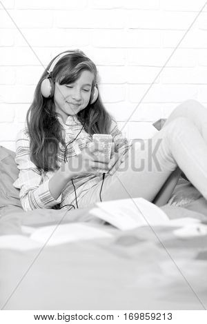 Girl listening to music at home