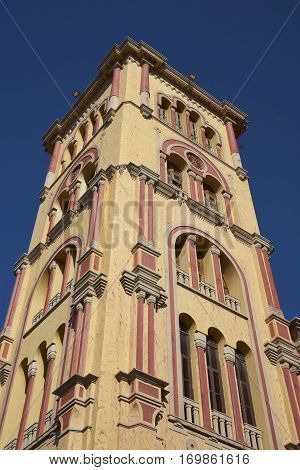 Colourful square tower of the University of Cartagena in the historic Spanish colonial city of Cartagena de Indias in Colombia.
