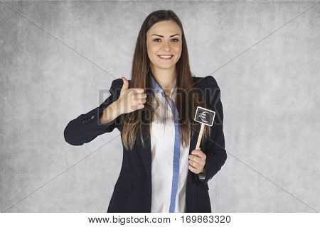 Happy Business Woman Shows Thumb Upwards For The Euro