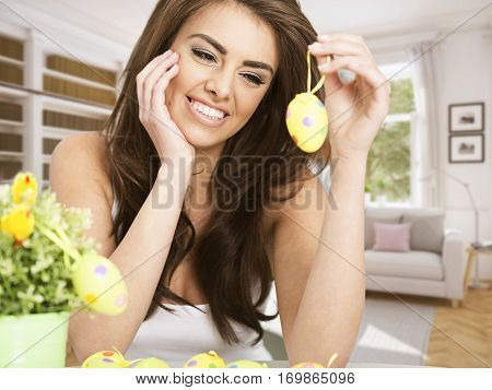 young smiling woman holding an easter egg