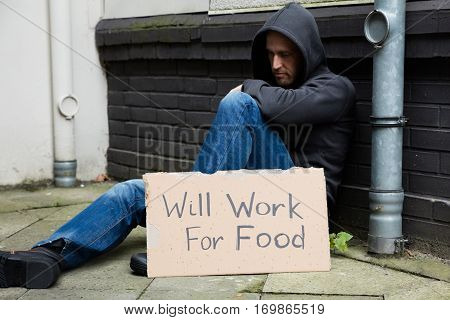 Sad Unemployed Man In Hood Willing To Work For Food