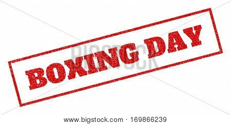 Red rubber seal stamp with Boxing Day text. Vector caption inside rectangular frame. Grunge design and dirty texture for watermark labels. Inclined sign.