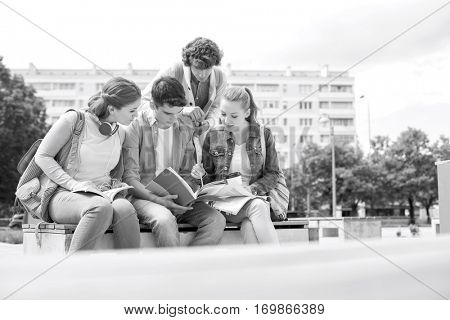 Group of friends studying together in university campus