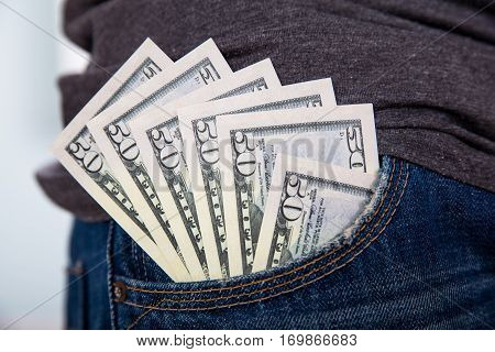 Close-up Of Fifty Dollar Currency Notes In Jean's Pocket