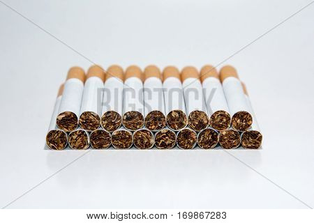 Nineteen cigarettes on a white background. Smoking is harmful. Smoking causes death. Nails in the coffin.