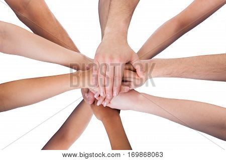 High Angle View Of A People Hand Stacked Together On White Background