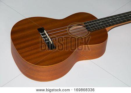 Detail of wooden ukulele isolated on white background