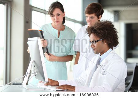 closeup of doctor and nurses in a meeting