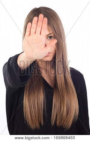 Pretty young girl making stop sign isolated on a white background