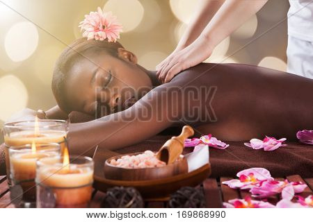 Young African Woman Receiving Back Massage At Beauty Spa