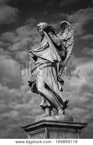 Statue of an angel standing on the bridge leading to the Castle Sant'Angelo, Rome. Angel with the Sudarium. designed by Bernini for Pope Clement IX.