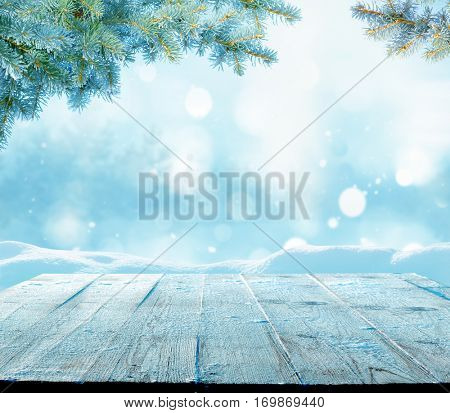 Merry Christmas and happy New Year greeting background with copy-space.Winter landscape with snow and Christmas trees.