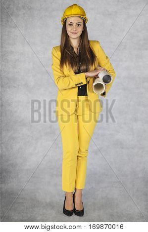 Business Woman Holds A Large Pile Of Construction Plans