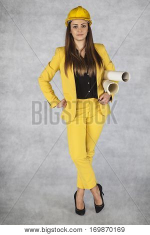 Young Lady Architect Holding Building Plans