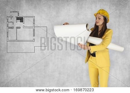 Business Woman Checks The Plans Of Apartment