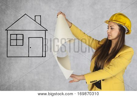 Construction Engineer Looks At A House Plan