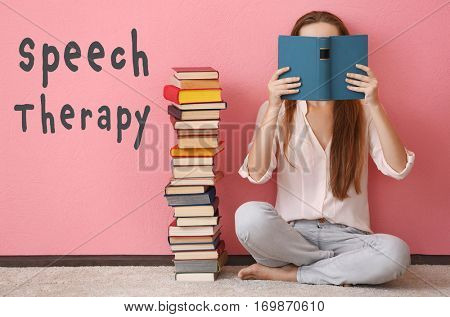 Woman reading book at home. Text SPEECH THERAPY on color background