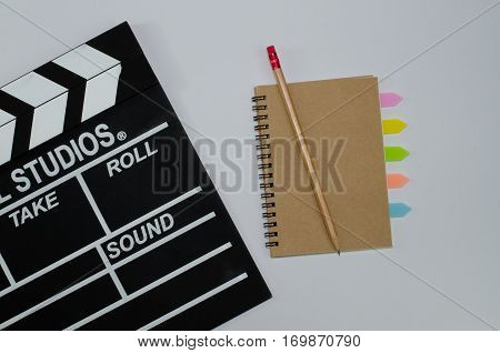 Slate film and notebook white background  hollywood, idea