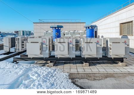 Moscow, Russian Federation, February 02, 2017: Air conditioning system Mitsubishi assembled and installed on top of a building.