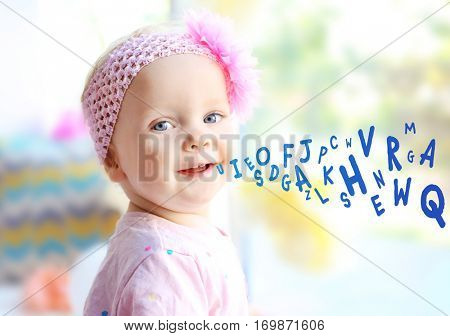 Little girl and alphabet letters on background. Speech therapy concept