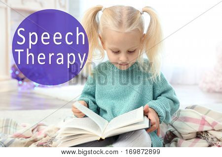 Little girl reading book at home. Text SPEECH THERAPY on background