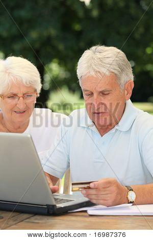 Senior couple doing on-line shopping