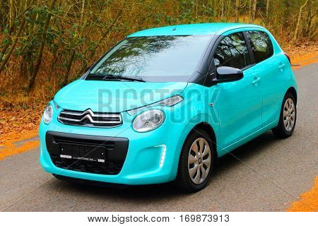 PILSEN CZECH REPUBLIC - DECEMBER 22, 2016: Small French car Citroen C1 with the PureTech 82 petrol engine uses ecologic technologies, for fuel consumption of 4.3l/100 km and CO2 emissions of 99g/km.