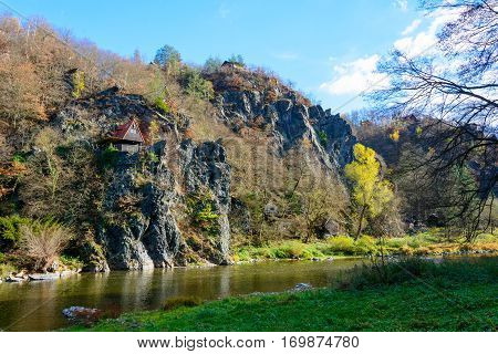 The old cottage in the village on the river Sazava. Autumn day at the river. Scouting in the Czech Republic. Hunter's life.